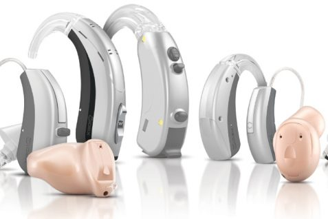 Different Types of Hearing Aids On Display In The White Background.
