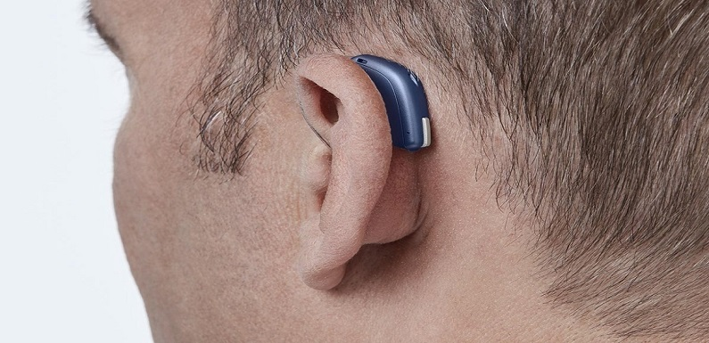 Modern digital in the ear hearing aid for deafness and the hard of hearing in man's ear.