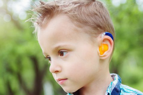 A Portrait of Little Boy Wearing Hearing Aid.