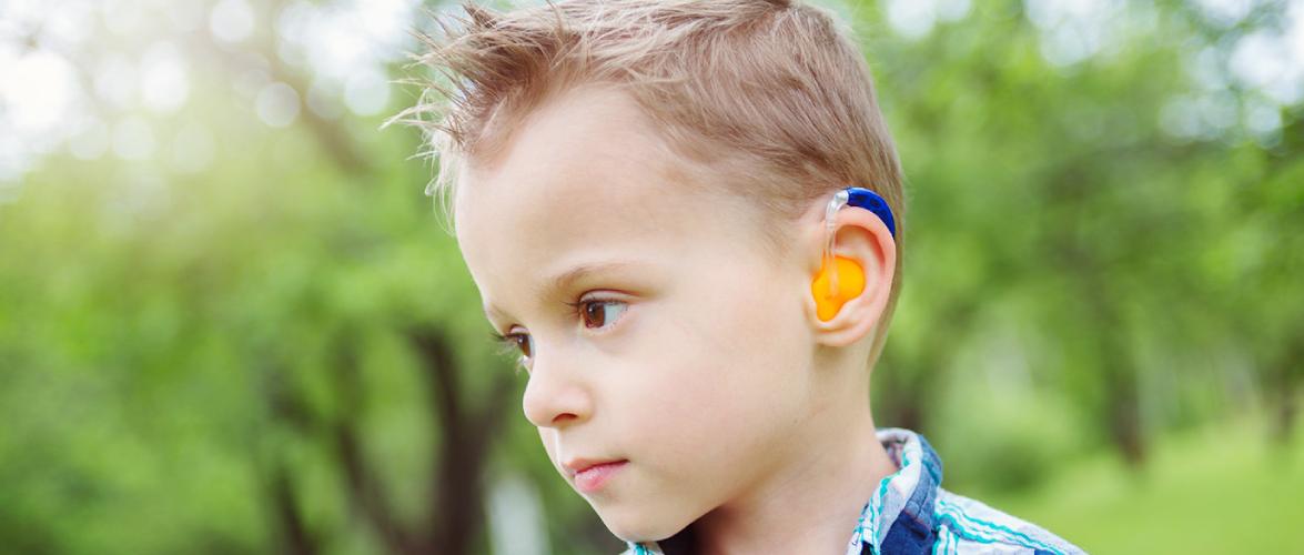 A Portrait of Little Boy Wearing Hearing Aid.