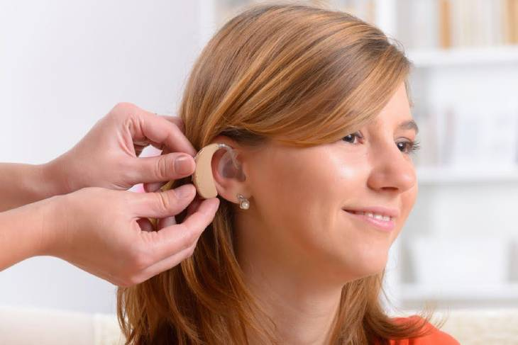 Representing An Audiologist Wearing Hearing Aid To Her Patient.