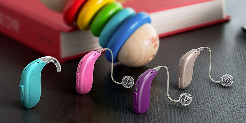 Colorful Hearing Aids Placed On The Table.